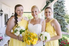 White & yellow bridesmaid dresses & bouquets