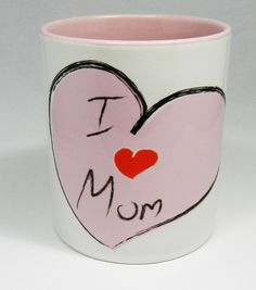 A Pale Pink Heart, with I love you Mum on it Ceramic Mug with pale pink glazed handle and inner . Perfect for Mothers Day or Mum's birthday. Designed and printed in Britain. A high quality ceramic mug which is both dishwasher and microwave proof. Height 9.5cm Diameter 8.2 cm, with a capacity of 310ml (11oz)). From the Series 1 Original Line Range by Half a Donkey Ltd. www.halfadonkey.co.uk