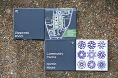 Directional wall signs at Stockwell Park Estate, UK by Hat-Trick Design