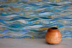 Oasis, a handmade mosaic shown in Peacock Topaz and Aquamarine jewel glass, is part of the Silk Road® collection by New Ravenna.