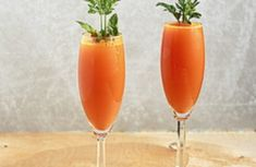 Carrot mimosas great for Easter! Carrot juice and Prosecco combine to make these cute, kitschy mimosas that couldn't be more perfect for Easter.