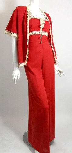 "Red crepe cotton 70s jumpsuit with palazzo wide legs, lace trim and jacket. Labeled ""Rags by Kressandra""."