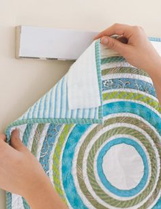 Add a shot of color and graphic impact to any room with these unexpected wall treatments: rugs and quilts.