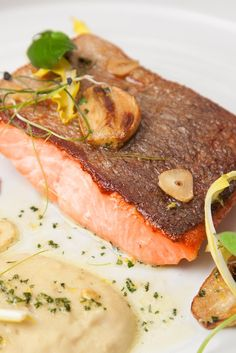 This recipe sees beautiful pan-fried trout fillets paired with a creamy white bean purée and garlic crisps for a delicate starter filled with heady flavour.
