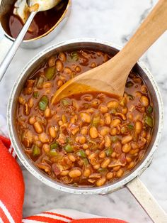 The Best BBQ Baked Beans ~      1 pound bacon, sliced     1 green bell pepper, seeded and diced     1 medium yellow onion, diced     1 3-pound (53 ounce) can pork & beans     1 cup barbeque sauce     ⅓ cup brown sugar     1 tablespoon mustard