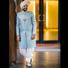 A powder blue kurta-dhoti outfit set for the groom.Pastel outfit inspiration for Indian groom. Unique Outfits, Cool Outfits, Groom Outfit Inspiration, Groom Trends, Royal Blue Lehenga, Blue Sherwani, Red Kurta, Straight Cut Pants, Wedding Outfits For Groom