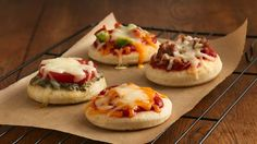 Individual pizzas make a scrumptious snack or appetizer. Unroll the pizza dough, cut with a round cutter and add toppings.