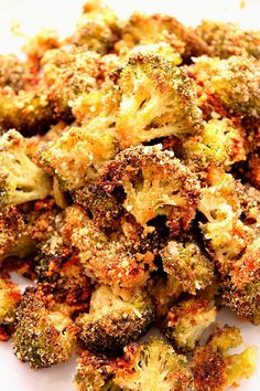 Garlic Parmesan Roasted Broccoli Recipe - the best broccoli ever! Perfectly roasted broccoli with crunchy garlic Parmesan coating.