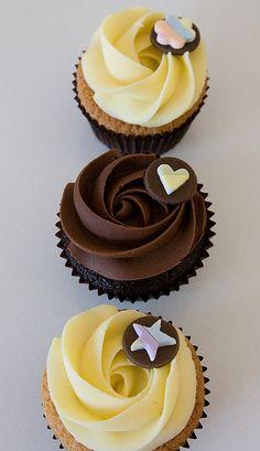 Chocolate mud cupcakes and Vanilla cupcakes topped with white chocolate ganache and dark choc ganache.