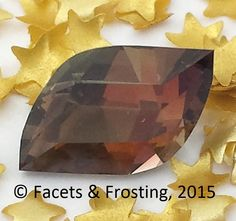 Andalusite, 1.46 cts, 8.2x5.6mm, Eternal Flame v1 cut (my own design).  Color looks brown in one direction, and there are hints of olive-green when viewed from another angle.  <AVAILABLE> on website