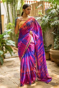 Did somebody say 'Shibori'? We cannot stop crushing on all manner of attractive Shibori dyed ware! Two thumbs up to this Shibori dyed purple drape in semi kota doria fabric. You are bound to look forever trendy in this beautiful saree. Put your creative cap on and pair this wonder with a blouse of varied hues and textures. Or stay cool as ever in a blue or a purple blouse.#kalamkari #saree #india #blouse #houseofblouse