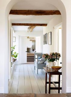 White floors, simple decor, farmhouse style