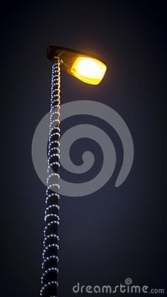 Luminaria decorated for Christmas and New Year. #adorned #bulb #cables #christmas #conductors #decorated #electricity #high #holiday #lamp #led #lighting #luminaire #luminaria #night #ornaments #post #street #streetlight #tungsten #wires #postedeluz