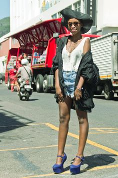 Today Zethu is wearing a bomber jacket by Yves St Laurent, shorts by Guess, Shoes by Jeffrey Campbell, gold necklace form Mr Price, hat and sunnies from a street vendor at the Parade and a chiffon tank top from Lovelee Boutique (Kloof St, CT).