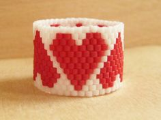 HEARTS BEADED RING