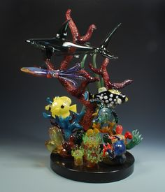 """""""Healthy Reef"""" Flameworked borosilicate glass, 22 inches tall. 10 inch granite base. Made by Jeremy Sinkus 2012. Shark, Clown trigger, butterfly, crab, sea anemones, turtle, squid."""