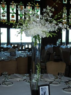 A white centerpiece of white hydrangea and dendrobium orchids