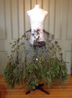 diy chicken wire dress form.........tutorial | ... from the bottom, I weave the branches through the chicken wire