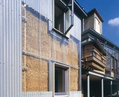 Straw Bale House by Sarah Wigglesworth. Straw bale insulation is revealed by polycarbonate cladding.