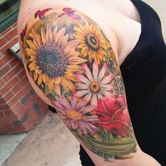 33 Tatouages avec des chiffres romain - 11 https://tattoo.egrafla.fr/2016/02/02/modeles-tatouage-tournesol/