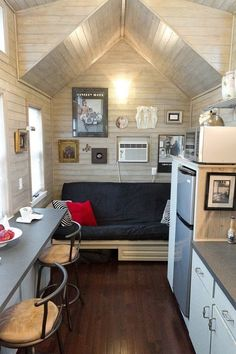 White-washed wood panels pair perfectly with the grey and white color scheme in this tiny house