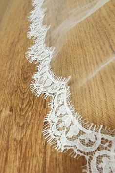 Stunning narrow Chantily lace edging available in white or ivory which can be added to any of our Irish made Veils , and in any length.