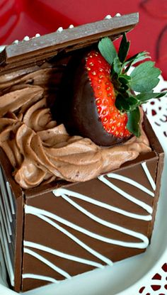 How to make a Chocolate Valentine Treasure Box filled with Chocolate Mousse and Chocolate Covered Strawberries. What a show-stopping dessert. Consider personalizing the top cover with a name or meaningful message!