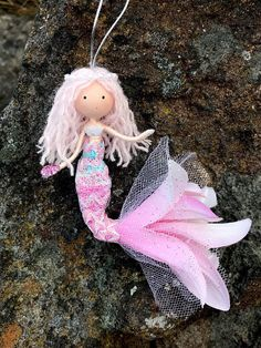 This listing is for a hanging ornament. Meet Ava! She's a mermaid from the Aegean Sea who loves searching for sea glass and shells. With the items she finds she shares them with her friends and family. She also loves to explore islands by swimming up rivers and streams. She is