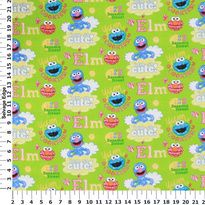 Licensed Cotton Prints - Sesame Street Characters on Green Cotton Fabric
