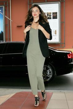 Miranda Kerr Pumps - As Miranda racks up those frequent flier miles, she never ceases to look amazing. She is seen here rockin' some killer gladiator heels, which perfectly match her long t-shirt dress.