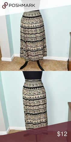 Gorgeous Black & Bronze Print Skirt In excellent condition! Very comfortable, stretchy, and flowy! Buy 3 items and get 1 free plus 15% off your purchase total! Skirts Midi