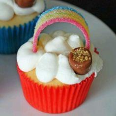 Rainbow cupcakes: marshmallow, fruit snack, chocolate, nuts