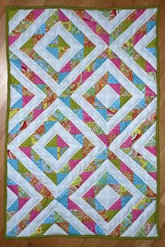 Half Square Triangles Quilt by Andrea F, via Flickr