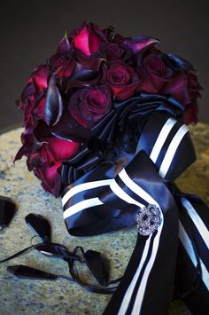 Black Baccara roses and magenta calla lilies wrapped in black-and-white ribbon make a striking bride's bouquet. Photography: Barnet Photography. Read More: http://www.insideweddings.com/weddings/ashley-reeves-and-brandon-saller/261/