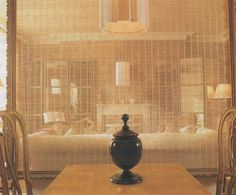 Hang a frame with semi-sheer fabric as divider in room - Barry Dixon for Diane Sawyer's home