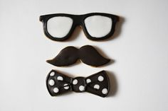 my dad! That's him: mustache, bow-tie, glasses (iced sugar cookies)