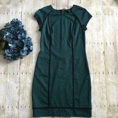 """dark green sheath dress with exposed zipper Dark green color with black detailing. Exposed zipper halfway in back. Size small. 76% polyester, 20% rayon, and 4% spandex. Measurements: armpit to armpit 15 inches and length 37 inches.  ❌ No trades or off Poshmark transactions.   Quick shipping.   Offers welcome through """"Make an Offer"""" feature.    Bundle discount.   ❔ Feel free to ask any questions. Mossimo Dresses"""