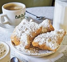 """Cafe du Monde BEIGNETS ** New Orleans """"donuts"""" ** dusted with powdered sugar ** use your bread machine or mixer with bread dough hook * fried puffs ** recipe and photo from Cafe du Monde"""