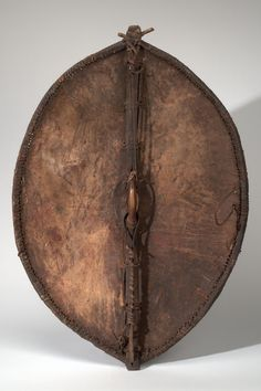 MAASAI shield (back)  Country: KENYA Material: HIDE, WOOD, PIGMENT, COATING Dimensions: L:96.5 W:69 [in CM] Acquisition Year: 1953