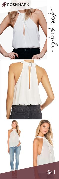 JUST IN! FREE PEOPLE NWT Twist Keyhole Top 🔑 Soft and oh so feminine Free People high neckline with twist detailing and closure in back top, meant to hit at the hips, machine washable, clasp detail in back is not adjustable, model wears a xs, NWT (tag is a little ripped up just in case it's a gift!) Free People Tops Blouses