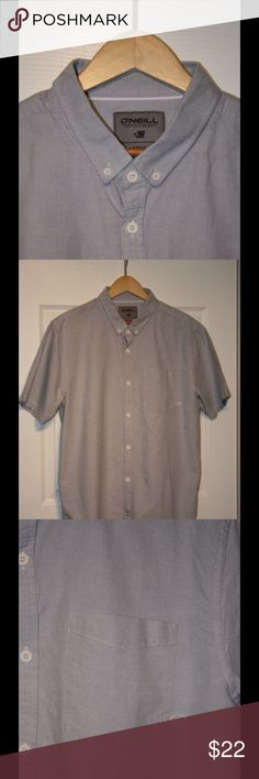 Mens button up chambray shirt. Mens O'Neil brand button up short sleeve shirt with patch pocket and subtle desigh non back. See last picture! O'Neill Shirts Casual Button Down Shirts