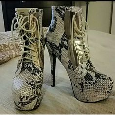 STEVE MADDEN PLATFORM PYTHON BOOTIES These are beautiful. In perfect condition.  Black and white faux python lace up. Gold plaques . Steve Madden Shoes Ankle Boots & Booties