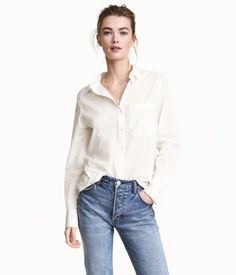White. Straight-cut shirt in airy cotton fabric with a collar, chest pocket, and long sleeves with buttons at cuffs.