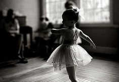Cute little Girl wearing Tutu in her Ballet Dancing Class in Black and White.