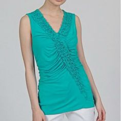 Turquoise Ruffle V-neck Tank An asymmetrical ruffle v-neck with 92% Rayon and 8% spandex.     Worn twice.   Second picture is the actual shirt. Grace Elements Tops Tank Tops