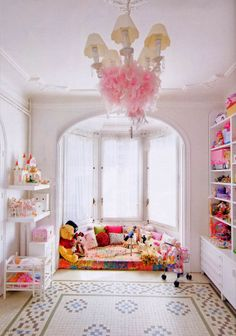 pink girls bedroom love the idea of hanging what looks to be a feather boa in the chandelier. Aren`t all the colours amazing in this little girls room. She will grow up very happy, if the colours in her room have anything to do with it!