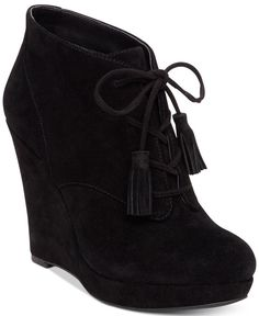 Tassels and a retro platform wedge heel bring a fun bohemian vibe to almost any ensemble with Jessica Simpson's Cyntia ankle booties. | Suede upper; manmade sole | Imported | Round-toe lace-up platfor