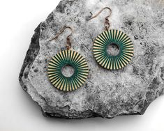 This is one of my favorite earrings because they have made from reclaimed old wood. Hand-formed with red, green and black radial lines to give a more kinetic feel. They will be perfect with a t-shirt and jeans or dressed up for an event. Wooden Earrings, Earrings Handmade, Handmade Chandelier, Circle Shape, T Shirt And Jeans, Old Wood, Chandelier Earrings, Red Green, I Shop