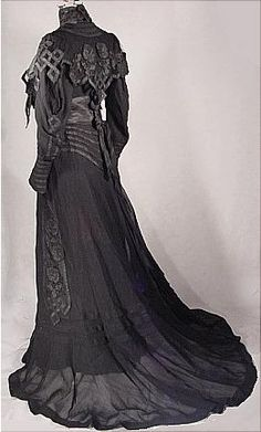 Circa 1904 Black Etamine Fancy Trained Reception Gown with appliques in Taffetas.