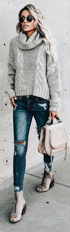 Cute gray cable knit sweater with distressed denim jeans.